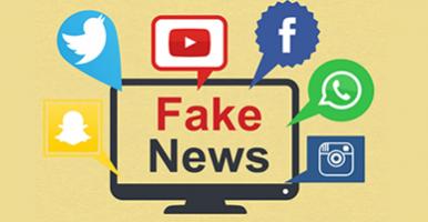 """Imagem. Tela de um computador com as palavras """"fake news"""" escritas. Em volta da tela os símbolos do Twitter, snapchat, facebook youtube, whatsapp e uma câmera."""